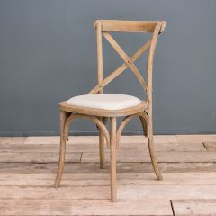 Crossback limewashed upholstered chair
